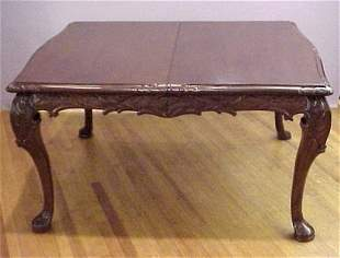 CARVED MAHOGANY DINING TABLE W/LEAF