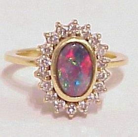 BEAUTIFUL BLACK OPAL & DIAMOND RING