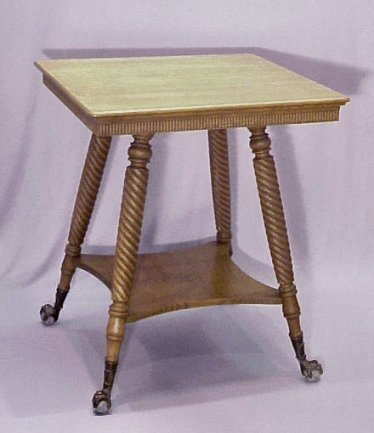1003A: GOLDEN OAK SPLAY LEG PARLOR TABLE