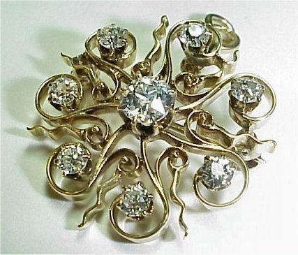 1005B: 14K SUNBURST DIAMOND PENDANT BROOCH