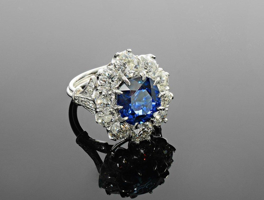 12.77 CTW SAPPHIRE & DIAMOND PLATINUM RING