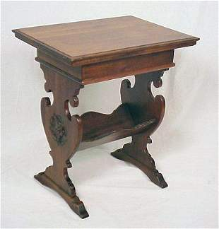 CARVED WALNUT BOOK TABLE