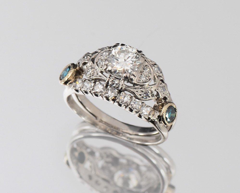 PLATINUM .60 CT CENTER DIAMOND RING W/ BLUE DIAMOND