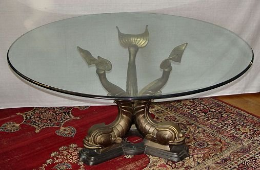 1019A: LARGE GLASS TOP DOLPHIN BASE TABLE