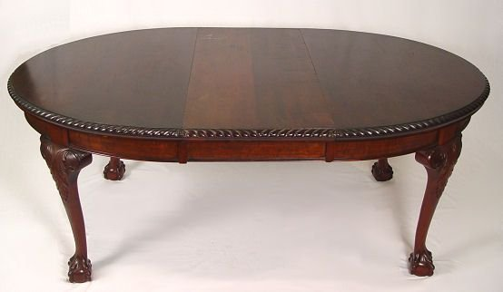 15: OVAL MAHOGANY BALL AND CLAW FOOT DINING TABLE
