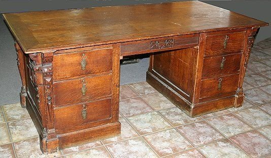 1019: ANTIQUE CARVED OAK EXECUTIVE DESK