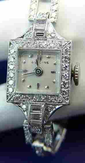 LADY'S PLATINUM DIAMOND WRIST WATCH GLYCINE SWISS
