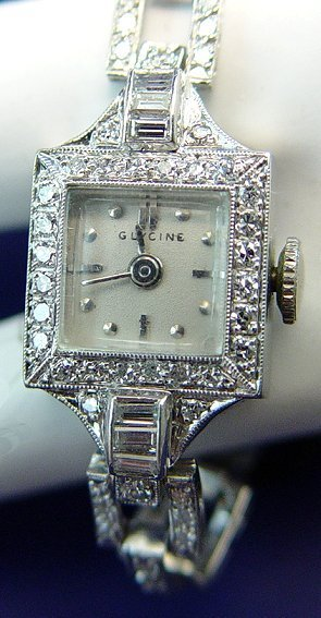1011: LADY'S PLATINUM DIAMOND WRIST WATCH GLYCINE SWISS