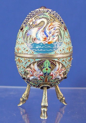 17: RUSSIAN SILVER AND ENAMEL EASTER EGG