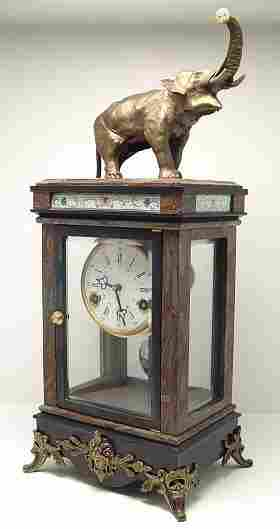 FRENCH STYLE MANTLE CLOCK SURMOUNTED BY ELEPHANT