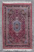 APPROX 2035 YR OLD INDOPERSIAN HAND KNOTTED WOOL RUG