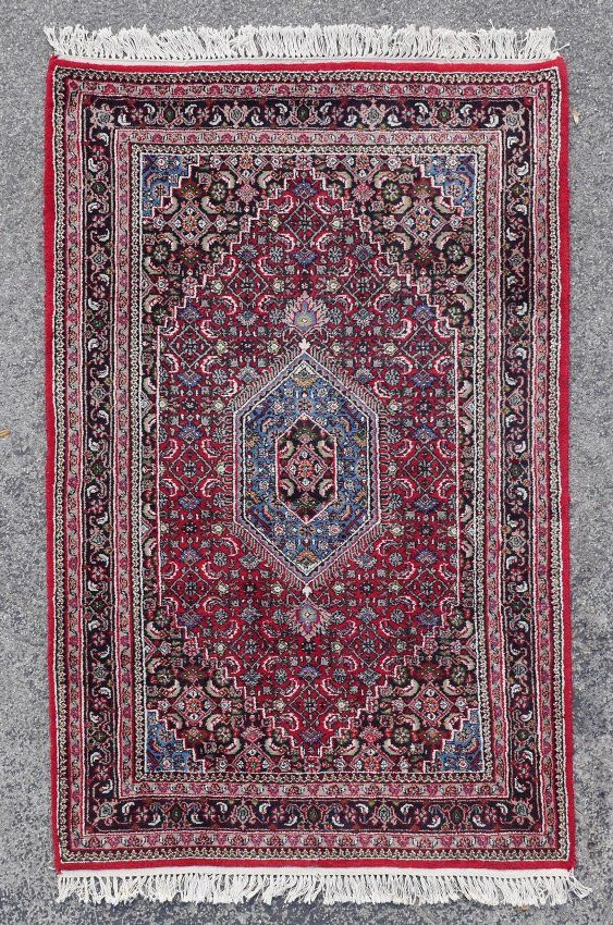 APPROX. 20-35 YR OLD INDO-PERSIAN HAND KNOTTED WOOL RUG