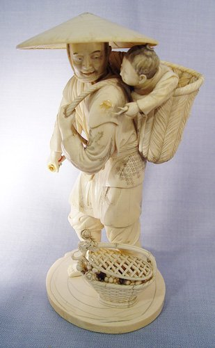 1001: JAPANESE CARVED IVORY FIGURE child in basket