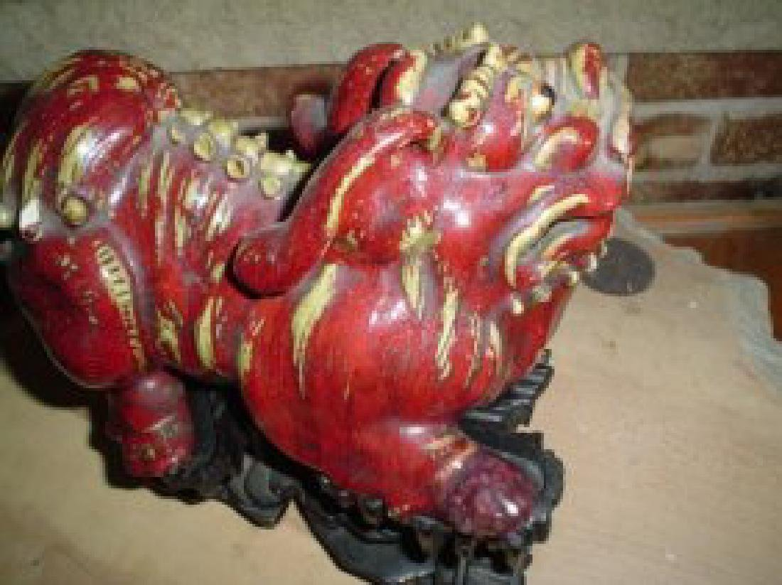 Chinese ming lion on the wood stand