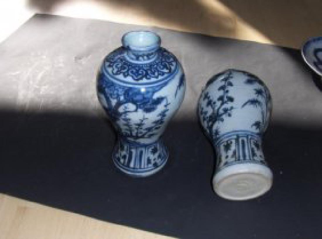 A pair of Chinese blue ming dynasty dark period vases