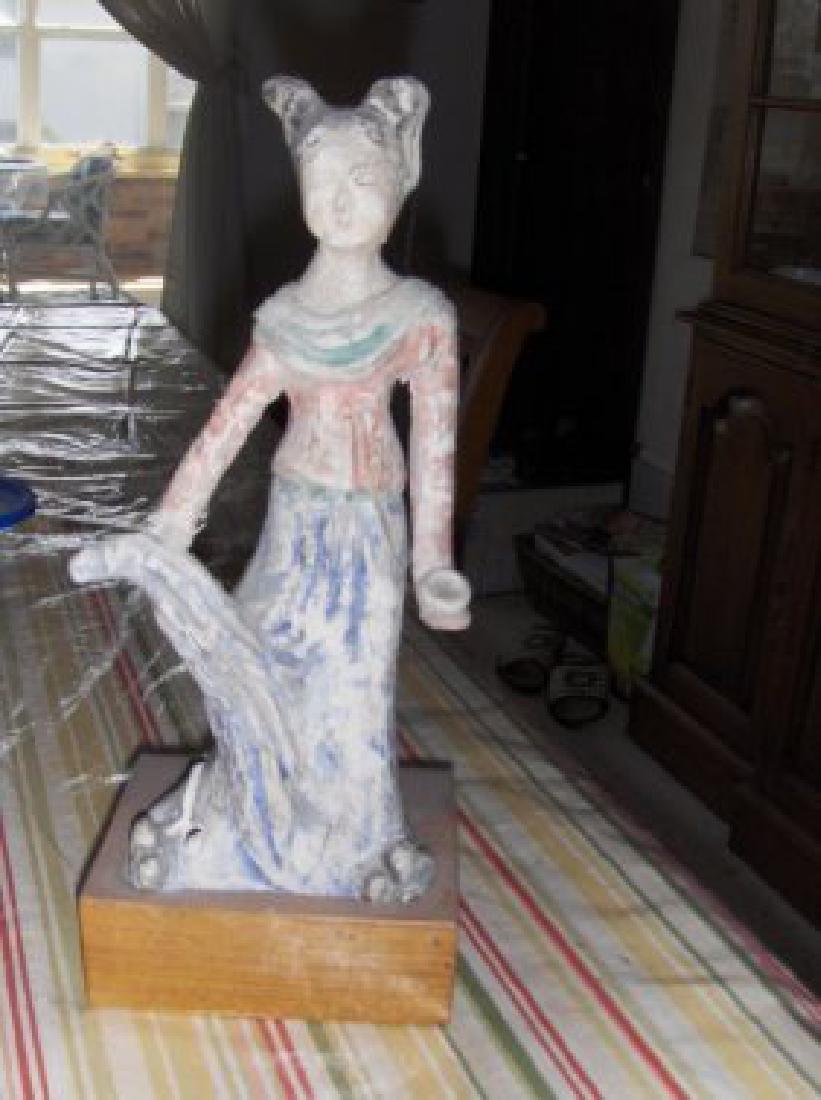 A Jin clay statue. (265AD - 420AD)