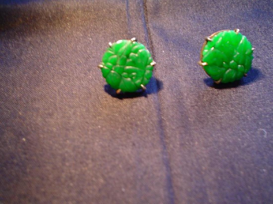 A pair Chinese 14K jadeite earrings