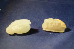 two small white jade carvings.