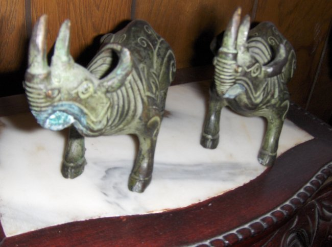 Chinese a pair of bronze carving rhinos, qing dynasty.