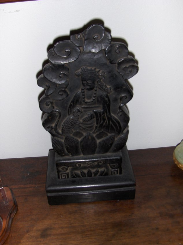 a black northern wei god carving.