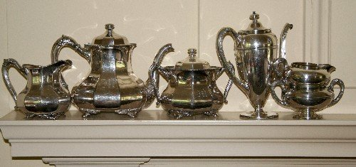 11: Two American Silverplate Tea Three Piece Services,