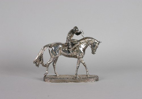 12: An English Silvered Figure of a Jockey and Horse. H