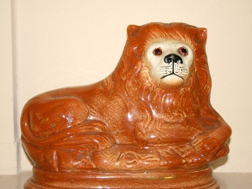 534: A Staffordshire Figure of a Lion. Height 9 inches.