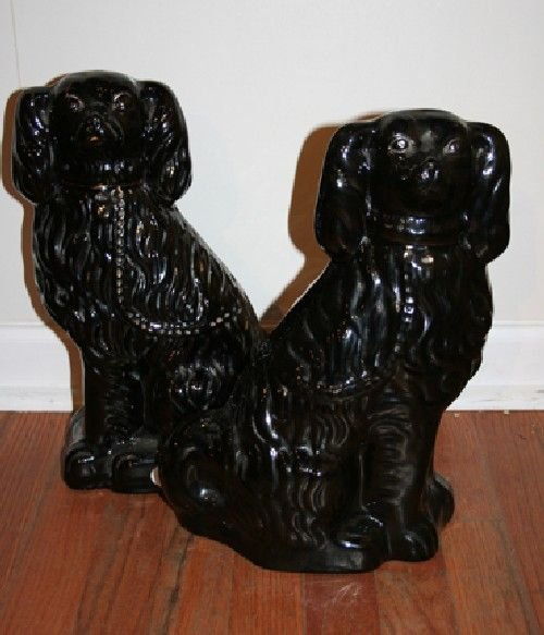 535: A Pair of Black Glazed Staffordshire Figures of Sp