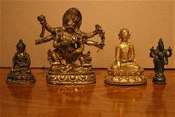 803: A Group of Four Southeast Asian Bronze Figures of