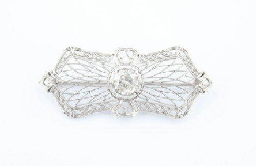 7: A Lady's 14 Karat White and Diamond Filigree Brooch,