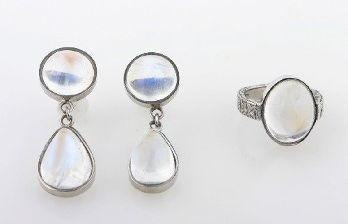 8: A Pair of White Gold and Moonstone Earrings and Ring