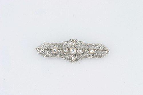 9: A White Gold and Diamond Filigree Style Bar Pin,