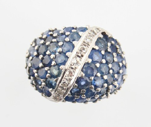 10: A White Gold, Blue Sapphire and Diamond Ring,