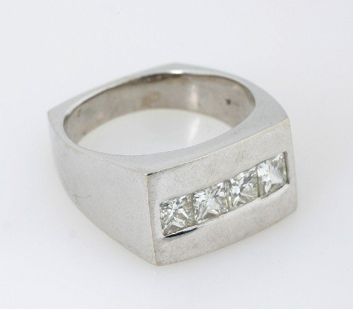 12: A 14 Karat White Gold and Diamond Ring, Eve Alfille