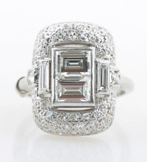 14: A Platinum and Diamond Art Deco Ring,