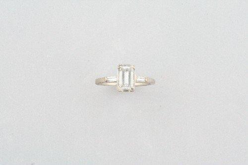16: A 14 Karat White Gold and Diamond Ring,