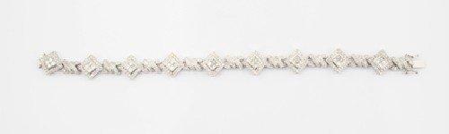 17: An 18 Karat White Gold and Diamond Bracelet, Length