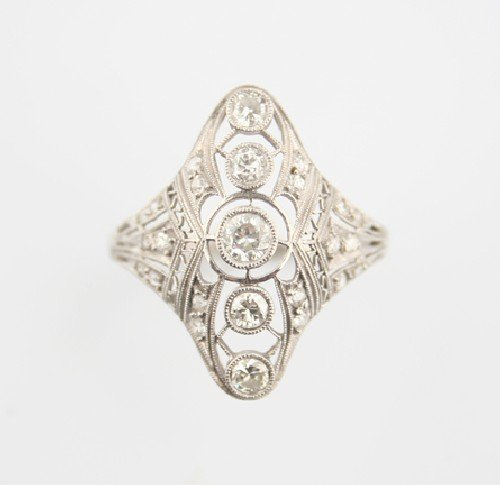 20: A Platinum and Diamond Filigree Ring,