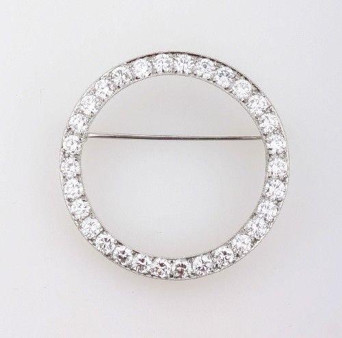 22: A Platinum and Diamond Circle Pin,
