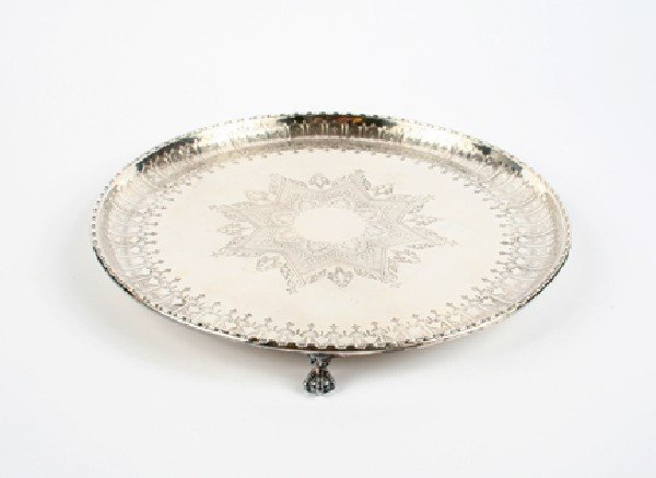 647: An English Footed Salver, Diameter 12 inches.