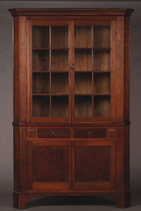 25: An American Walnut Corner Cupboard,