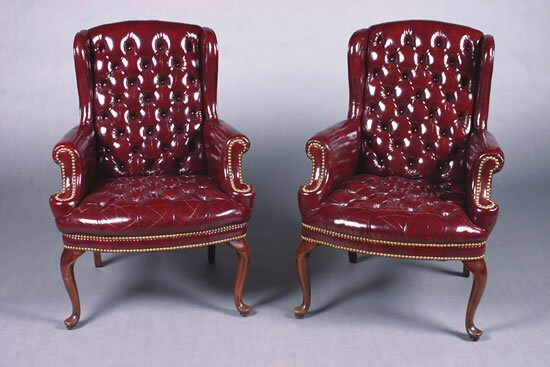 27: A Pair of Mahogany and Red Leather Upholstery Wing