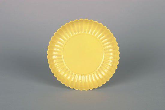 A Chinese Yellow-Glazed Foliate Saucer Dish,