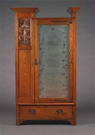 An English Arts & Crafts Oak Wardrobe,