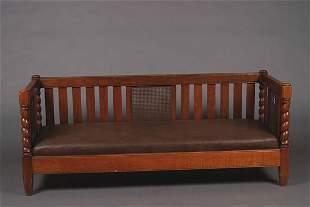 An Arts & Crafts Oak Settee,