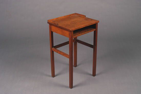 An Arts and Crafts Oak Telephone Table,