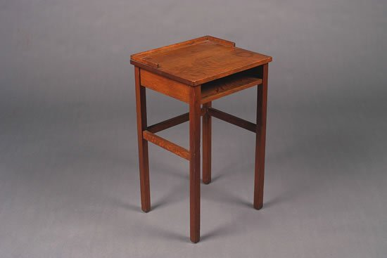 1238: An Arts and Crafts Oak Telephone Table,