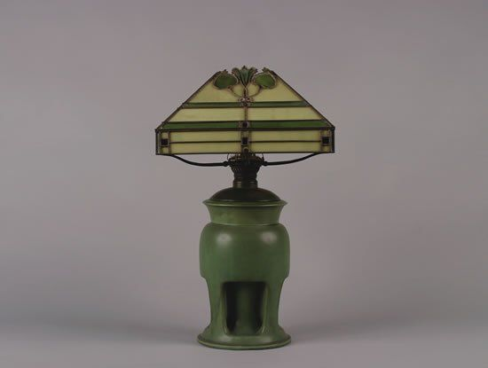 A Teco Art Pottery Lamp with Leaded Glass Shade,