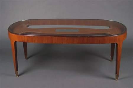 1297: A Mahogany and Glass Dining Table, by Paolo Buffa