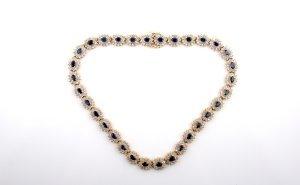 6: A 14 Karat Yellow Gold, Diamond and Sapphire Necklac
